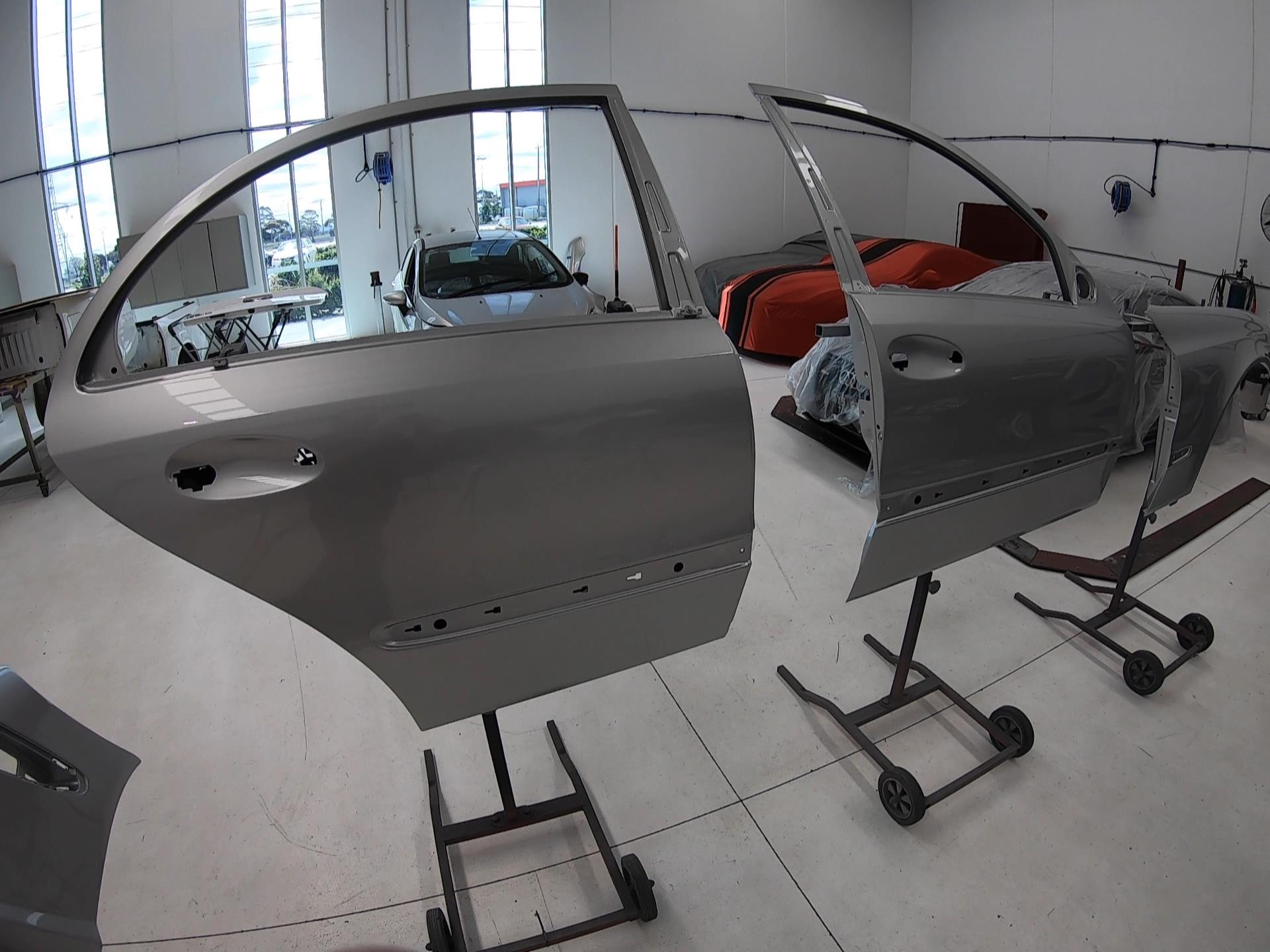 The doors painted during a Mercedes auto body repair.