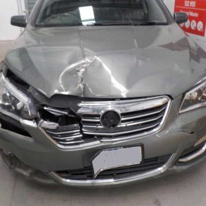 Showcasing the front damage to the Holden