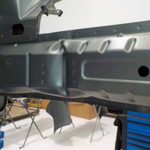 The holden panel beaters providing an up close image of the chassis damage to the frame.