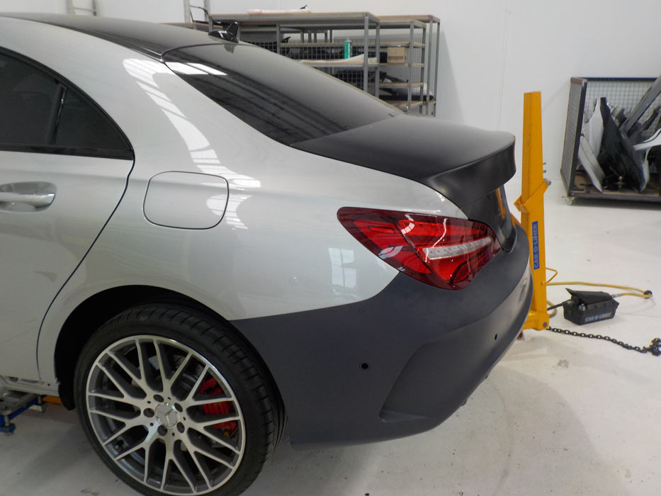 Fitting this Mercedes with genuine parts for a truly undetectable finish
